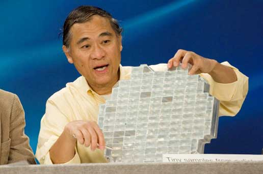 Dr. Peter Tsou Holds a Sample Tray