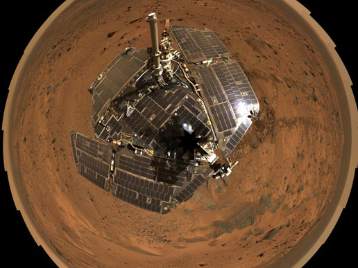 A self-portrait of the spacecraft deck and a panoramic mosaic of the Martian surface as viewed by NASA's Mars Exploration Rover Spirit.