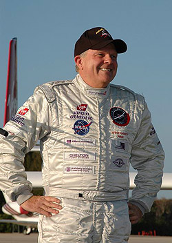 Steve Fossett wearing his flightsuit while talking to reporters.