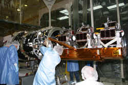 Image of Engineers securing the ST5 launch support structure to the Pegasus rocket