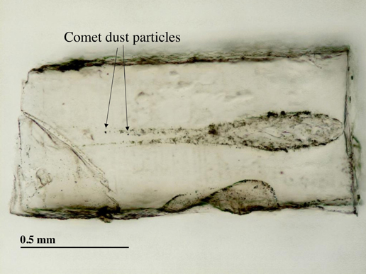 A slice of aerogel removed with an ultrasonic blade, showing comet particles and tracks.