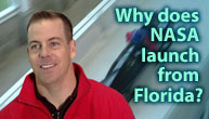 A man in a red sweatshirt stands next to the words Why does NASA launch from Florida? as a bobsled races by in the background