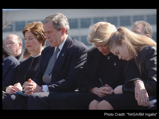 President Bush and the First Lady pray with the Columbia families