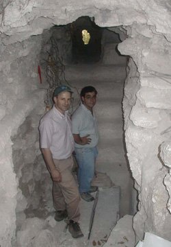 Scientist Daniel Irwin and archaeologist Dr. William Saturno explore a trench below an ancient Maya pyramid in Guatemala.