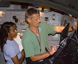 JSC2005-E-40279 -- STS-121 Mission Specialists Piers  Sellers and Stephanie Wilson