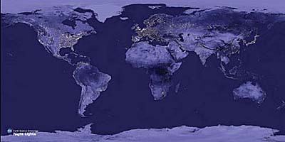 An image of the Earth's surface with bright light visible from the large cities