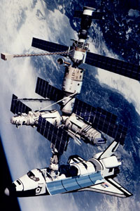 A rendition of the Space Shuttle Atlantis docked to the Kristall module of the Russian Mir Space Station
