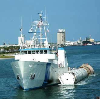 Freedom Star tows a booster at Port Canaveral.