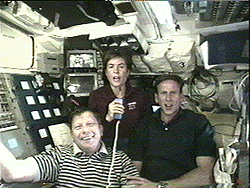 Three astronauts on the space shuttle