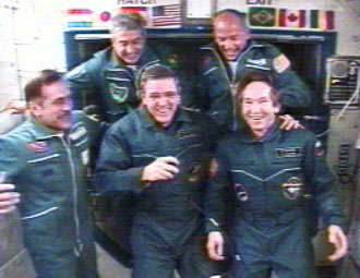 Expedition 12 and 13 crews and Marcos Pontes
