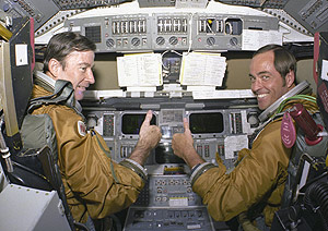 Young and Crippen give a thumps-up from inside Columbia's cockpit.