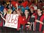 Photograph of a group of students holding a sign with the team number 1266 in red