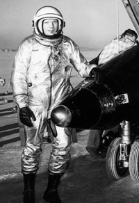 Portrait of Neil Armstrong standing next to the X-15 after a research flight. The X-15 was a rocket-powered aircraft 50 feet long with a wingspan of 22 feet.
