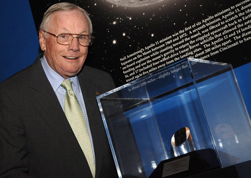 Neil Armstrong stands next to his Ambassador of Exploration Award.
