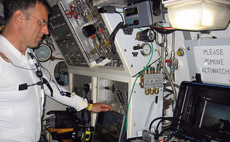 JSC2006-E-13560 -- Dave Williams monitors exterior Remotely Operated Vehicle operations.