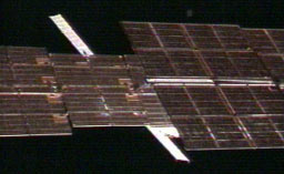 Progress 21 viewed behind solar arrays
