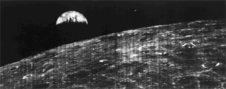 This historic image is the first view of Earth taken by a spacecraft from the vicinity of the Moon.