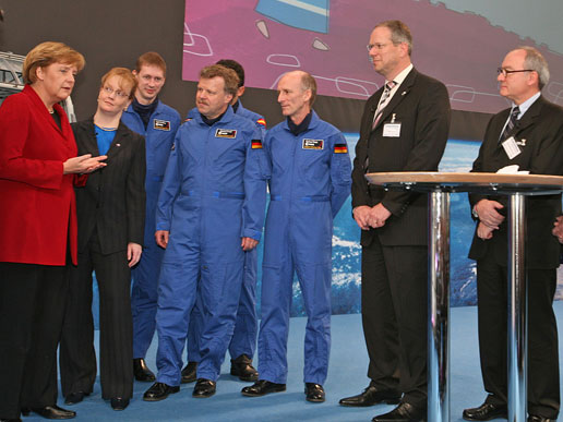 German Chancellor Angela Merkel, NASA Deputy Administrator Shana Dale and ESA officials mark the completion of the Columbus laboratory.