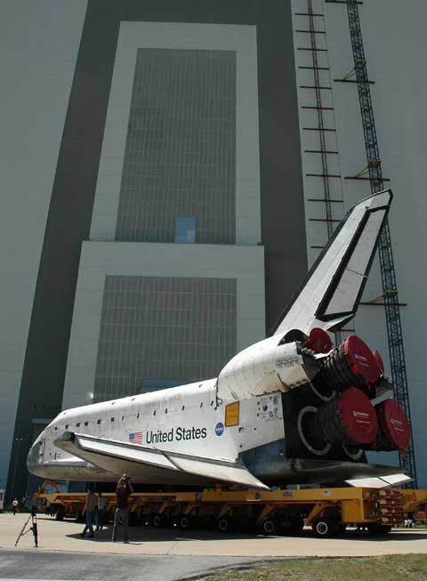 The orbiter Discovery is seen moving from its hangar to the Vehicle Assembly Building.