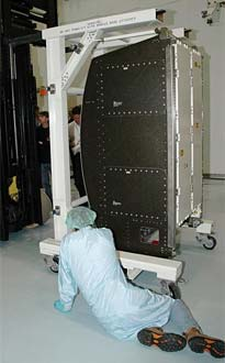 The Oxygen Generation System is uncrated after delivery to Kennedy Space Center