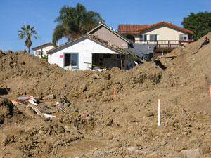 Damaged buildings are surrounded by mud in La Conchita, California, where winter storms on Jan. 15, 2005 caused fatal landslides that damaged private property and roads.