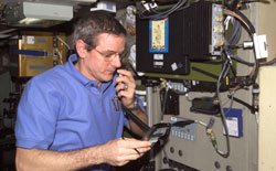 ISS012-E-21209 - Bill McArthur talks on station ham radio.