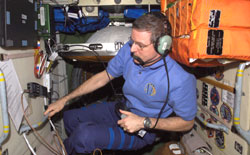 ISS012-E-21181 - Bill McArthur talks on station ham radio.
