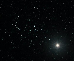 Saturn and the Beehive star cluster
