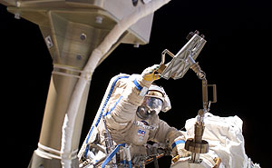 ISS013-E-29017 -- Astronaut Jeff Williams participates in the first extravehicular activity.