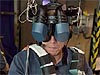 A man's face is almost completely covered by the goggles of the virtual reality mask he is wearing