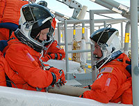 Commander Steven Lindsey and Pilot Mark Kelly take part in emergency egress practice