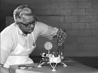 NASA researcher with Viking lander model, 1973.