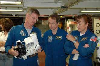 Mission Specialists Joseph Tanner, Steven MacLean, and Heidemarie Stefanyshyn-Piper.