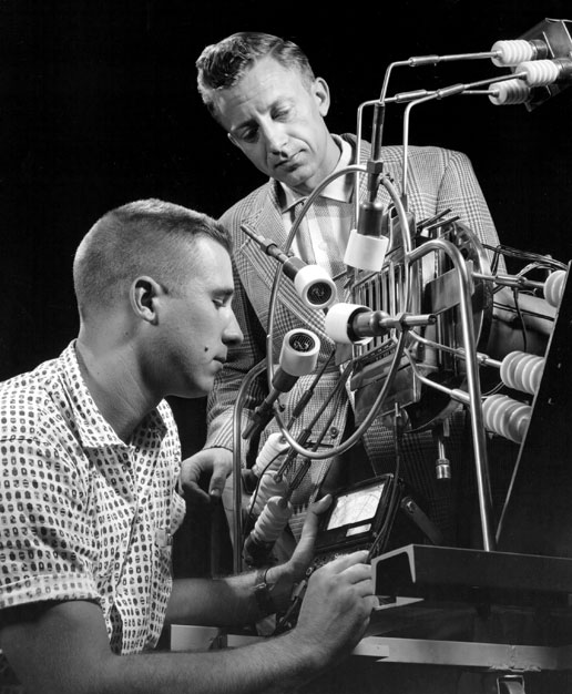 An engineer and a technician check out an ion engine in the Electronic Propulsion Research Building at the Lewis Research Center (now NASA's Glenn Research Center) in 1961.