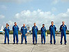 Mission STS-121 crew members pose for the media.