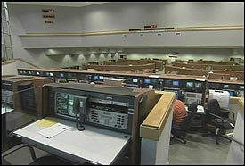 Rows of launch computer consoles fill the floor of Firing Room 4.
