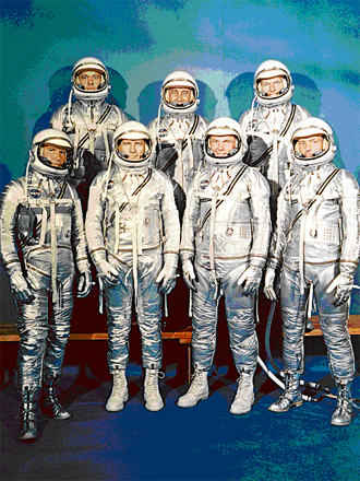 Project Mercury Astronauts, whose selection was announced on April 9, 1959, only six months after the National Aeronautics and Space Administration was formally established on October 1, 1958.   Despite the iconic status of this image, the site of the photograph has been uncertain.  According to a recent communication from Wally Schirra, the photo was taken at a meeting of the Space Task Group at Langley, sometime prior to Alan Shephard's flight in May, 1961.  Schirra notes that he was the spacesuit expert, and was wearing the only one fitted and eligible for flight.   Front row, left to right, Walter H. Schirra, Jr., Donald K. Slayton, John H. Glenn, Jr., and Scott Carpenter; back row, Alan B. Shepard, Jr., Virgil I. Gus Grissom, and L. Gordon Cooper.