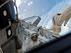 Mission Specialist Piers Sellers waves from the cargo bay during EVA.