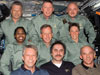 The STS-121 and Expedition 13 crewmembers gather for a photo.