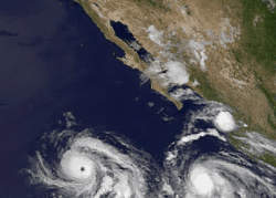 Still Image from a time lapse of GOES images showing the two hurricanes chasing after one another.