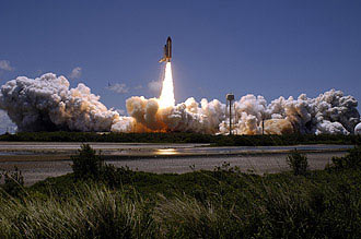 Space Shuttle Discovery launches into space on mission STS-121