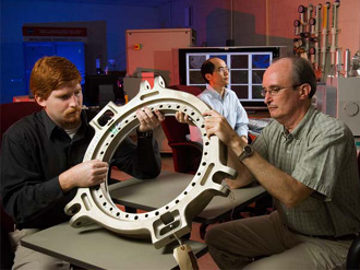 NASA engineers analyze a rotating ring from an Army helicopter rotor.