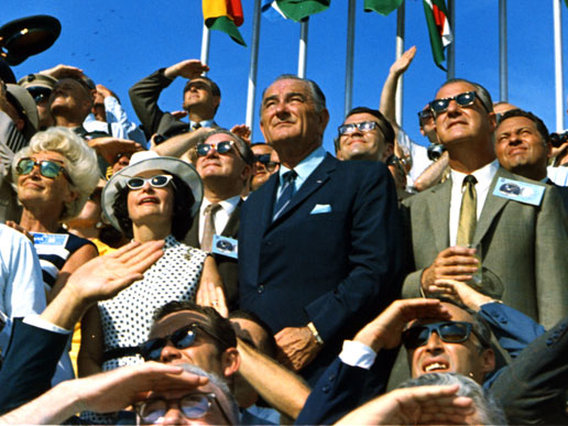 Vice President Spiro Agnew and former President Lyndon B. Johnson view the liftoff of Apollo 11.