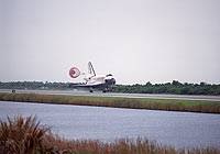 Discovery lands at Kennedy's Shuttle Landing Facility.
