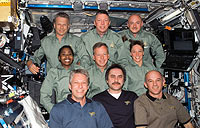 Group photo of the STS-121 and Expedition 13 crewmembers.