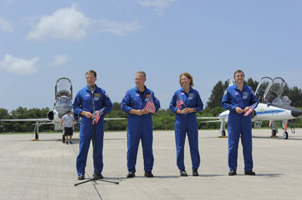 STS-135 crew members arrive at SLF for launch