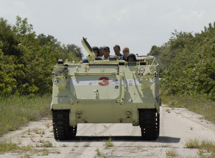 STS-127 Mission Specialist Chris Cassidy and other crew members practice driving the M-113 armored personnel carrier.