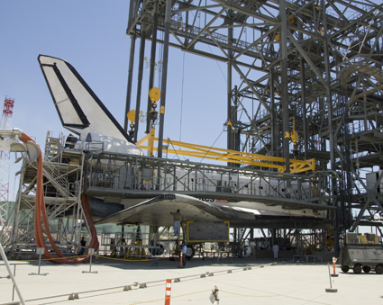 Space shuttle Atlantis is shown suspended from a sling in the Mate-Demate Device at NASA's Dryden Flight Research Center