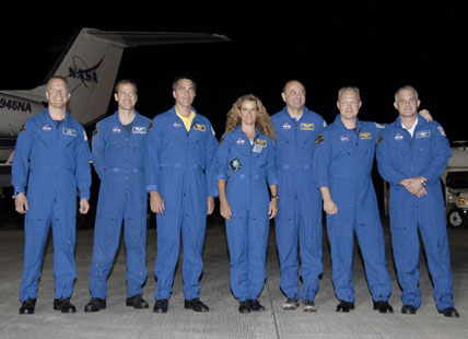 STS-127 crew poses for a group portrait following their arrival at the Shuttle Landing Facility.