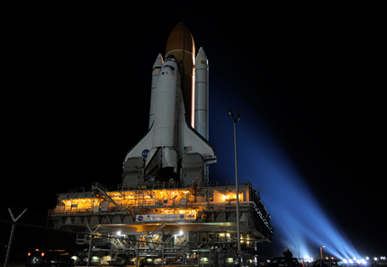 Space shuttle Discovery rolls to Launch Pad 39A.